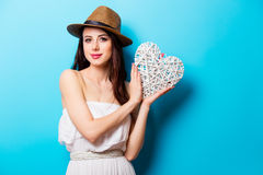 Beautiful young woman with heart shaped toy standing in front of Royalty Free Stock Photography