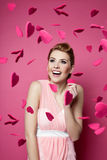 Beautiful young woman with hearts falling around Royalty Free Stock Images