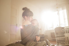 Beautiful young woman with her adorable little son stock photos