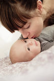 Beautiful young woman with her adorable little son royalty free stock images