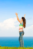Beautiful young woman with her arms in the air Stock Image