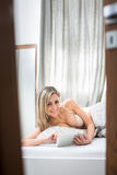 Beautiful young woman in her bed Royalty Free Stock Photography