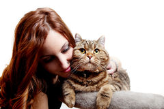 Beautiful young woman with her cat Stock Photos