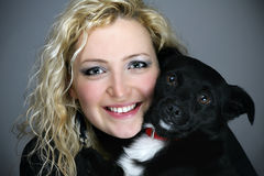 Beautiful young woman with her dog Royalty Free Stock Image