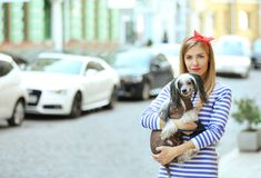 Beautiful young woman with her dog stock photos