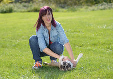 Beautiful young woman with her dog french bulldog Stock Photo