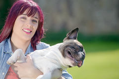 Beautiful young woman with her dog french bulldog Royalty Free Stock Photography