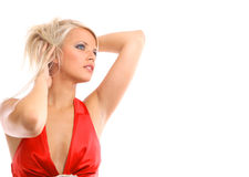 Beautiful young woman with her hair blowing and sm Royalty Free Stock Images