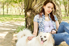 Beautiful young woman with her little dog Royalty Free Stock Images