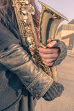 Beautiful young woman with her saxophone Stock Photography