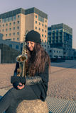 Beautiful young woman with her saxophone Royalty Free Stock Photo