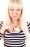 Beautiful young woman hiding cash Stock Images