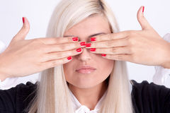 Beautiful young woman hiding his face with hands Royalty Free Stock Photography