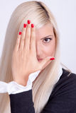 Beautiful young woman hiding his face with hands Royalty Free Stock Images