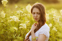 Beautiful young woman of high wildflowers Royalty Free Stock Image
