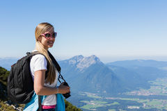 Beautiful young woman hiking in the mountains Stock Photos