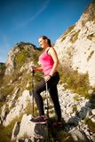 Beautiful young woman hiking in mountains on a sunny summer afte Stock Images