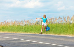 Beautiful young woman hitch hiking- in auto-stop Stock Photo