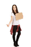 Beautiful young woman hitch hiking. Stock Images