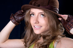 Beautiful young woman hold hat and smile Royalty Free Stock Images