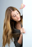 Beautiful young woman holding Royalty Free Stock Photos