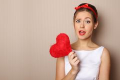 Beautiful Young Woman Holding A Red Heart Royalty Free Stock Image