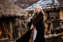 Free Beautiful Young Woman Holding A Viking With Blond Hair. Image Of Historical Figure Royalty Free Stock Photo - 156938425