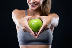 Free Beautiful Young Woman Holding An Apple Over Black Background. Royalty Free Stock Images - 104661169