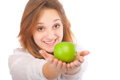 Beautiful young woman holding an apple Royalty Free Stock Images