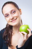Beautiful young woman holding an apple Stock Photos