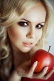 Beautiful young woman holding an apple Stock Photos