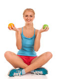 Beautiful young woman holding an apple and orange Stock Image