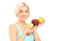 Beautiful young woman holding apples Stock Photography