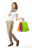 Beautiful young woman holding bags Stock Image