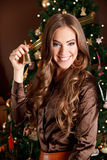 Beautiful young woman holding a bell at Christmas Eve Royalty Free Stock Photo