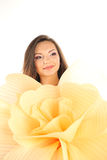 Beautiful young woman holding a big hand made flower wearing make up Stock Image