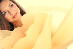 Beautiful young woman holding a big hand made flower wearing make up Stock Images