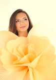 Beautiful young woman holding a big hand made flower wearing make up Stock Photography