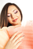 Beautiful young woman holding a big hand made flower wearing make up Royalty Free Stock Image