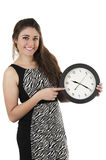 Beautiful young woman holding big round clock Stock Photography