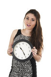 Beautiful young woman holding big round clock Royalty Free Stock Images