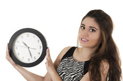Beautiful young woman holding big round clock time Royalty Free Stock Photography