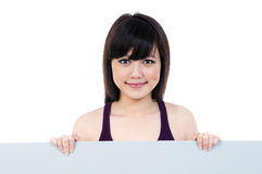 Beautiful young woman holding billboard Royalty Free Stock Photography