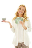 Beautiful young woman holding bills and house model - real estate loan concept Stock Images