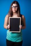 Beautiful young woman holding blackboard Stock Photo