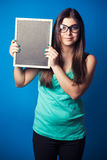 Beautiful young woman holding blackboard Stock Photography