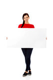 Beautiful young woman holding a blank banner.  Royalty Free Stock Photo