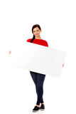 Beautiful young woman holding a blank banner.  Royalty Free Stock Images
