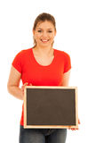 Beautiful young woman holding blank blackboard isolated over whi Royalty Free Stock Photography