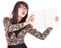 Beautiful young woman holding a blank book Stock Photography